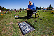 "Rudy Ramirez reflects at the grave of one of his ""homeboys,"" Daniel Mendoza, murdered in 2006. Oxnard, Calif. (photo by Gabriel Romero ©2011)"