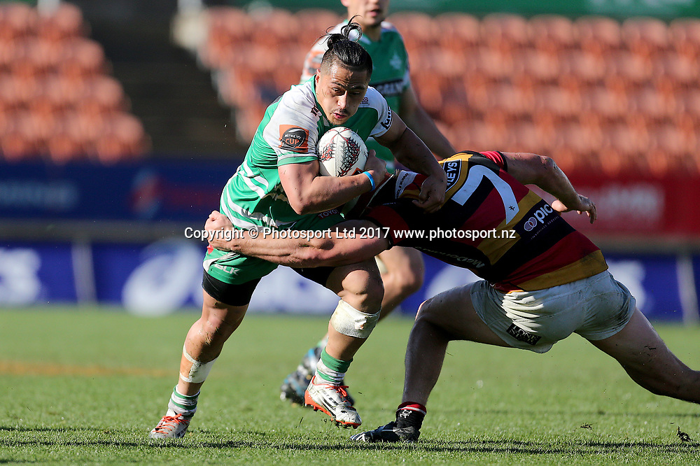 Manawatu second five Jason Emery looks to beat the tackle of Waikato flanker Mitch Jacobson during the Mitre 10 Cup rugby match - Waikato v Manawatu played at FMG Stadium Waikato, Hamilton, New Zealand on Saturday 16 September 2017.  <br /> <br /> Copyright photo: &copy; Bruce Lim / www.photosport.nz