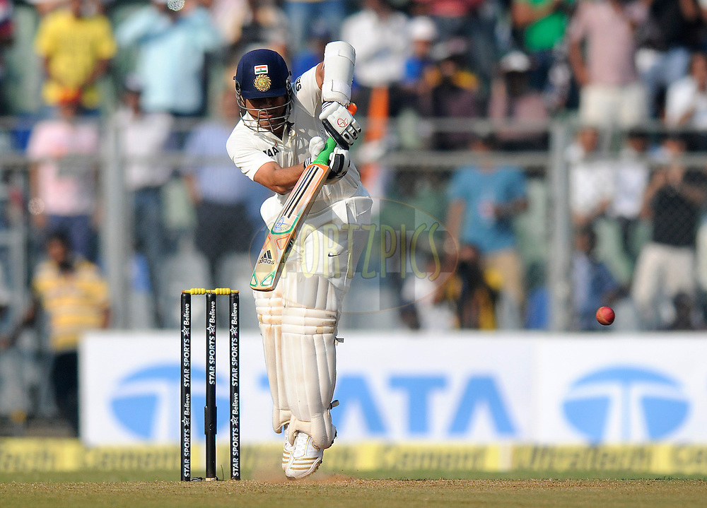 Sachin Tendulkar of India bats during day one of the second Star Sports test match between India and The West Indies held at The Wankhede Stadium in Mumbai, India on the 14th November 2013<br /> <br /> This test match is the 200th test match for Sachin Tendulkar and his last for India.  After a career spanning more than 24yrs Sachin is retiring from cricket and this test match is his last appearance on the field of play.<br /> <br /> Photo by: Pal PIllai - BCCI - SPORTZPICS<br /> <br /> Use of this image is subject to the terms and conditions as outlined by the BCCI. These terms can be found by following this link:<br /> <br /> http://sportzpics.photoshelter.com/gallery/BCCI-Image-Terms/G0000ahUVIIEBQ84/C0000whs75.ajndY