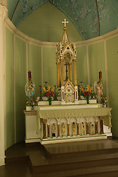 Hawaii: Molokai, church and gravesite at Kalawao of leper priest, Father Damien de Veuster.  Interior..Photo himolo162-71898..Photo copyright Lee Foster, www.fostertravel.com, lee@fostertravel.com, 510-549-2202