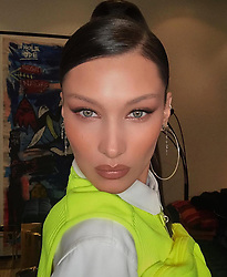 """Bella Hadid releases a photo on Instagram with the following caption: """"Shout out to Hung and Jennifer! \u2618\ufe0f\ud83d\udc9a\u2618\ufe0f"""". Photo Credit: Instagram *** No USA Distribution *** For Editorial Use Only *** Not to be Published in Books or Photo Books ***  Please note: Fees charged by the agency are for the agency's services only, and do not, nor are they intended to, convey to the user any ownership of Copyright or License in the material. The agency does not claim any ownership including but not limited to Copyright or License in the attached material. By publishing this material you expressly agree to indemnify and to hold the agency and its directors, shareholders and employees harmless from any loss, claims, damages, demands, expenses (including legal fees), or any causes of action or allegation against the agency arising out of or connected in any way with publication of the material."""