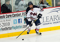 March 13 2016: Robert Morris Colonials forward Zac Lynch (27) looks to make a play with the puck during the first period in game three of the Atlantic Hockey quarterfinals series between the Bentley Falcons and the Robert Morris Colonials at the 84 Lumber Arena in Neville Island, Pennsylvania (Photo by Justin Berl)