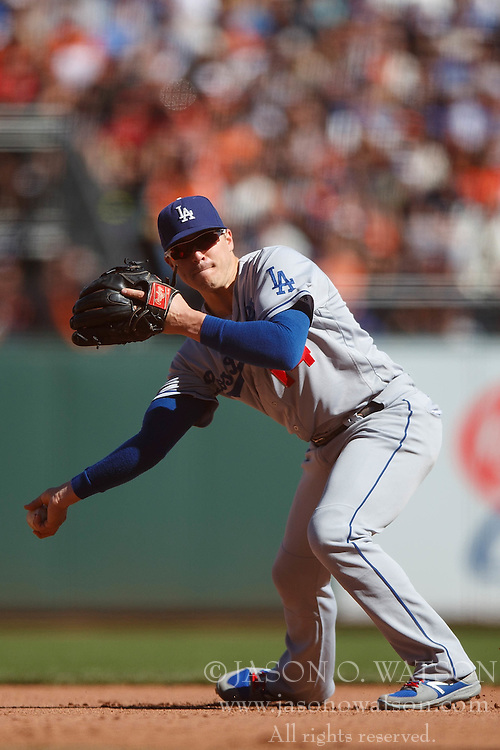SAN FRANCISCO, CA - OCTOBER 02: Enrique Hernandez #14 of the Los Angeles Dodgers throws to first base against the San Francisco Giants during the seventh inning at AT&T Park on October 2, 2016 in San Francisco, California. The San Francisco Giants defeated the Los Angeles Dodgers 7-1. (Photo by Jason O. Watson/Getty Images) *** Local Caption *** Enrique Hernandez