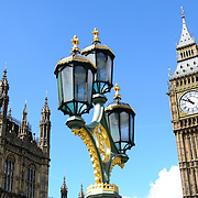 Big Ben and top of Palace of Westminster 169-095234640 The clock of Elizabeth Tower (commonly known as Big Ben) on the Palace of Westminster, with some of the ornate streets lights of Westminster Bridge in the foreground.
