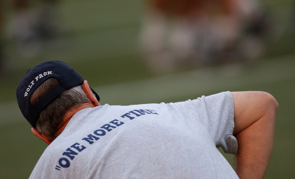 Nevada head coach Chris Ault watches the teams' final practice at Aloha Stadium in Honolulu, Dec. 23, 2005 before the Saturday's Sheraton Hawai'i Bowl on Christmas Eve. Ault is wearing his &quot;Nevadatude&quot; team t-shirt with the slogan &quot;One More Time&quot; written on the back.<br />