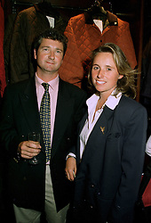 MR TIM HENSON Director of Gatcombe Park Horse Trials and MISS LUCY JENNINGS at a party in London on 17th July 1997.MAJ 11