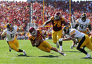 September 10, 2011: Iowa State Cyclones quarterback Steele Jantz (2) scrambles with the ball as Iowa Hawkeyes defensive back Tanner Miller (5) and Iowa Hawkeyes defensive back Collin Sleeper (10) close in during the first half of the game between the Iowa Hawkeyes and the Iowa State Cyclones during the Iowa Corn Growers Cy-Hawk game at Jack Trice Stadium in Ames, Iowa on Saturday, September 10, 2011. Iowa State defeated Iowa 44-41 in 3OT.