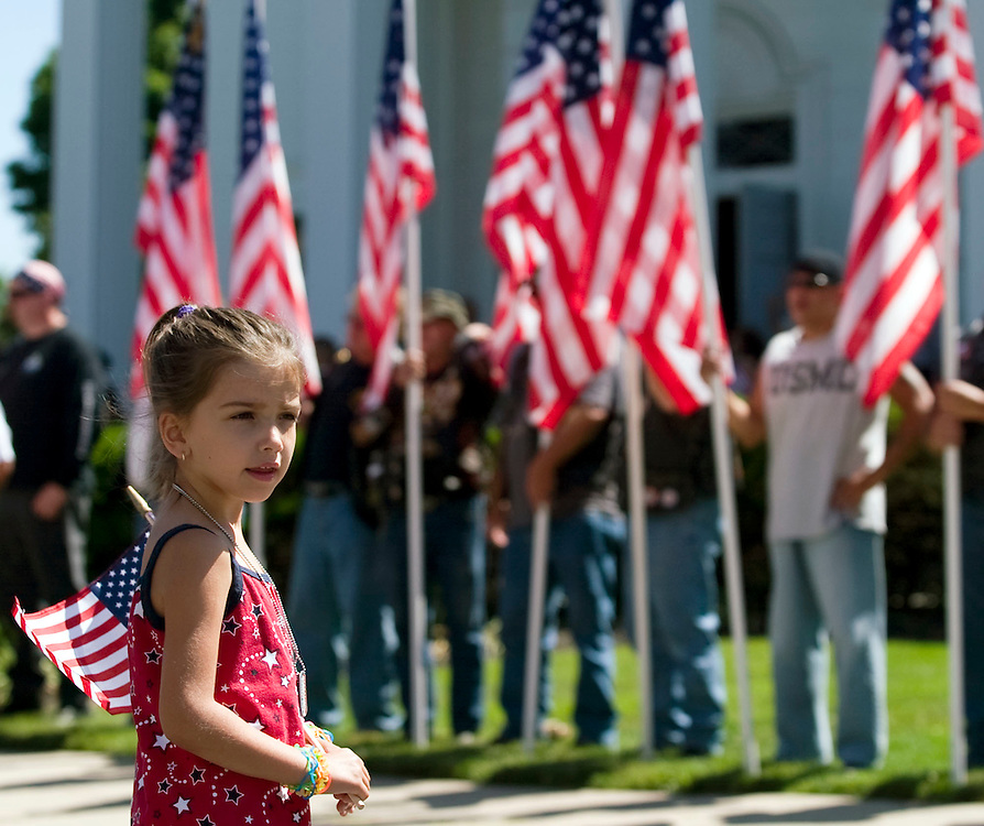 (070310, Fall River, MA)..Alexis Alves, 6, watches the procession at the Holy Name Church in Fall River, MA, on Saturday, July 3, 2010 where a memorial service was held for Spc. Scott Andrews, 21, of Fall River.  Andrews was killed on June 21 by an improvised explosive device while serving in Afghanistan...Staff Photo by Brooks Canaday..Saved in Sunday