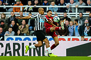Trent Alexander-Arnold (#66) of Liverpool hacks the ball clear under pressure from Jose Salomon Rondon (#9) of Newcastle United during the Premier League match between Newcastle United and Liverpool at St. James's Park, Newcastle, England on 4 May 2019.