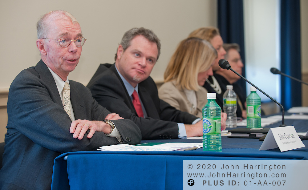Panelist John Courson, President & CEO of Mortgage Bankers Association speaks as Mark Fleming, Chief Economist of CoreLogic looks on in a panel discussion on housing finance reform presented by Radian at the Rayburn House Office Building in Washington, DC on January 21st, 2011. Radian, a company that facilitates the sales of affordable mortgages and provides private mortgage insurance brought together top executives from similarly focused companies to discuss housing finance reform and how private and public sectors play a role in it.