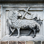A lamb, the symbol of St John the Baptist, on the outside of the Old St. John's Hospital in Bruges, Belgium. Old St. John's Hospital is one of Europe's oldest surviving hospital buildings that dates to the 11th century. It originally treated sick pilgrims and travelers. A monastery and convent was later added. It is now a museum.