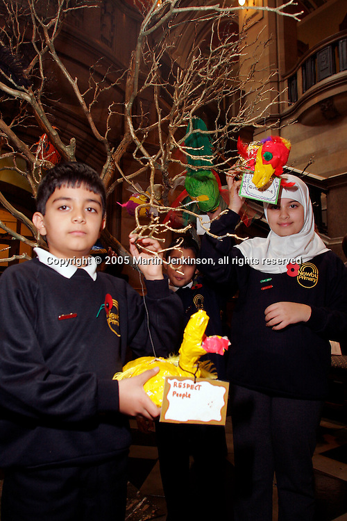 Pupils from Newby Primary School decorating a Peace Tree as part of the Bradford District Peace Festival...© Martin Jenkinson, tel 0114 258 6808 mobile 07831 189363 email martin@pressphotos.co.uk. Copyright Designs & Patents Act 1988, moral rights asserted credit required. No part of this photo to be stored, reproduced, manipulated or transmitted to third parties by any means without prior written permission