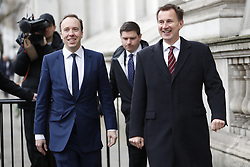© Licensed to London News Pictures. 12/03/2019. London, UK. Health Secretary Matt Hancock (L) walks to Cabinet with Foreign Secretary Jeremy Hunt ahead of the meaningful vote on the Brexit withdrawal agreement in The House of Commons later. Photo credit: Peter Macdiarmid/LNP