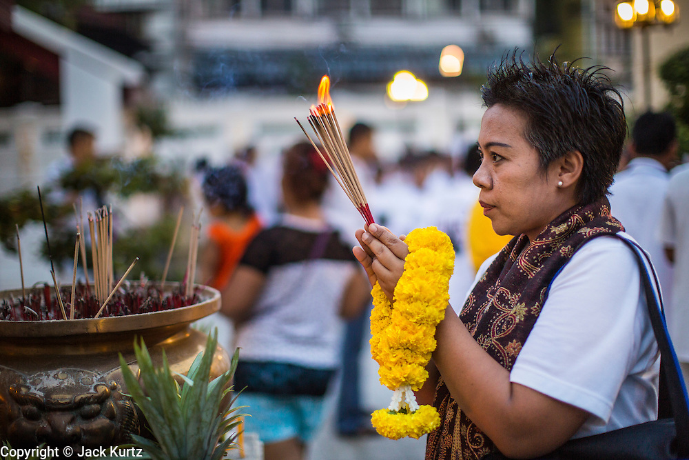 27 JANUARY 2013 - BANGKOK, THAILAND:  A woman prays during Thaipusam at Dhevasathan (the Brahmin Shrines) on Dinso Rd in Bangkok. Thaipusam is a Hindu festival celebrated primarily by the Tamil community in South East Asia on the full moon in the Tamil month of Thai (Jan/Feb). Pusam refers to a star that is at its highest point during the festival. The festival commemorates both the birthday of the Hindu god Murugan, son of Shiva and Parvati, and the occasion when Parvati gave Murugan a vel (a lance) so he could vanquish the evil demon Soorapadman. The holy day is celebrated by Brahmins in Thailand. Brahmanism was the court religion before Buddhism came to Thailand and before the foundation of Sukhothai. Both religions are combined in the Thai way of life and its customs and ceremonies.      PHOTO BY JACK KURTZ