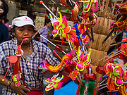 "17 FEBRUARY 2015 - BANGKOK, THAILAND: A vendor sells Chinese New Year toys in Bangkok's Chinatown district. Chinese New Year is February 19 in 2015. It marks the beginning of the Year of Sheep. The Sheep is the eighth sign in Chinese astrology and the number ""8"" is considered to be a very lucky number. It symbolizes wisdom, fortune and prosperity. Ethnic Chinese make up nearly 15% of the Thai population. Chinese New Year (also called Tet or Lunar New Year) is widely celebrated in Thailand, especially in urban areas like Bangkok, Chiang Mai and Hat Yai that have large Chinese populations.       PHOTO BY JACK KURTZ"