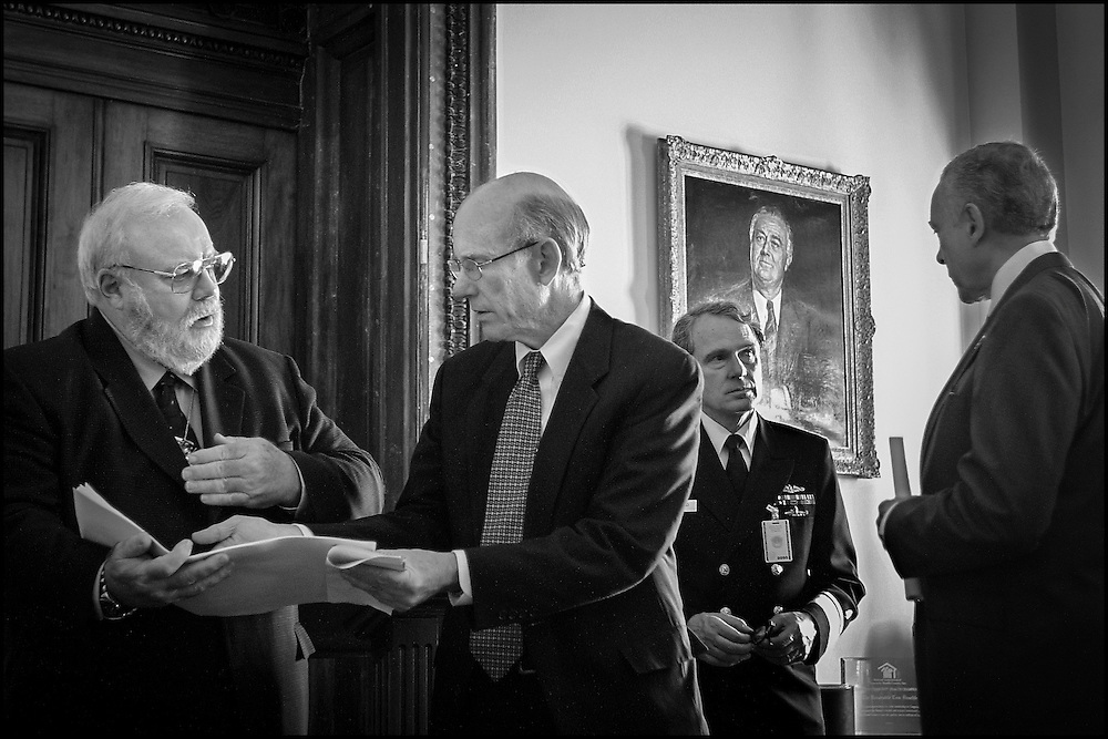 After a meeting in Senator Daschle's office concerning the reopening of the Hart Building Incident Commander David Stutz talks to Sen. Pat Roberts while looking over the floor plan of the Hart Building...To the right Sen. Hatch confers with Attending Physican for the Capitol Dr. John Eisold.  10/24/01.  .©PF BENTLEY/PFPIX.com