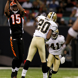 2009 August 14: Cincinnati Bengals wide receiver Chris Henry (15) catches a pass over cornerback Randall Gay (20) during a preseason opener between the Cincinnati Bengals and the New Orleans Saints at the Louisiana Superdome in New Orleans, Louisiana.