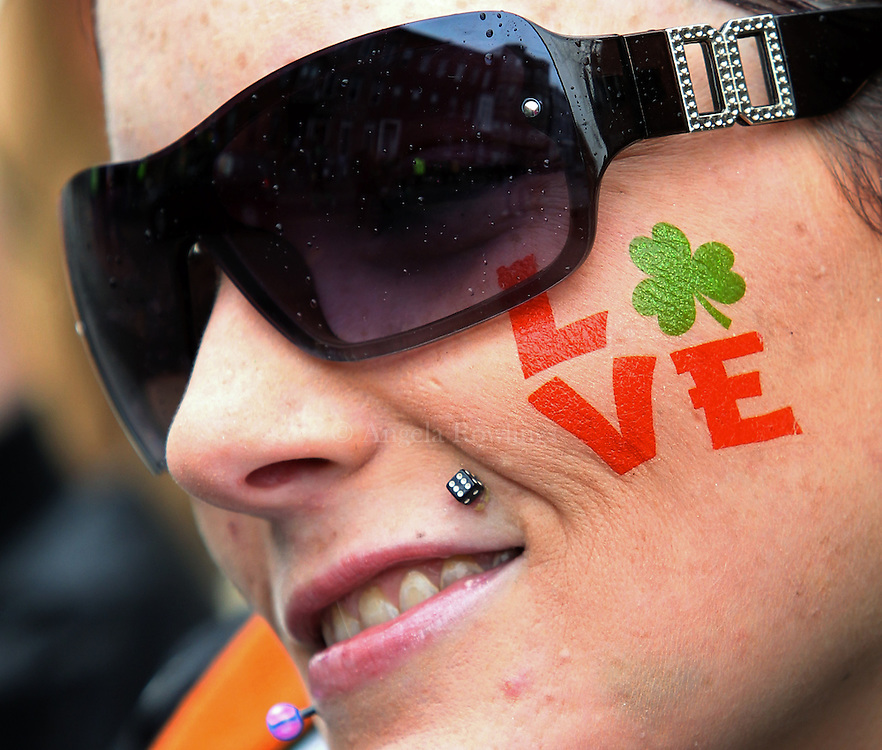 (Boston, MA - 3/15/15) Alazay[cq] Allen watches the St. Patrick's Day Parade in South Boston, Sunday, March 15, 2015. Staff photo by Angela Rowlings.