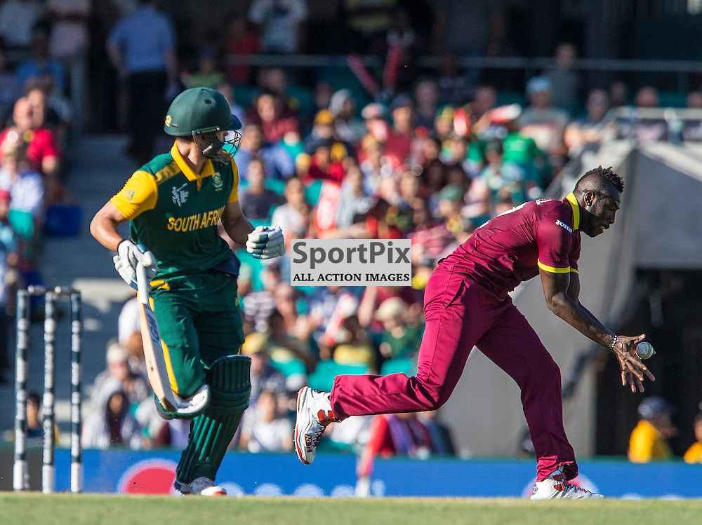 ICC Cricket World Cup 2015 Tournament Match, South Africa v West Indies, Sydney Cricket Ground; 27th February 2015<br /> West Indies Andre Russell fields a ball as South Africa&rsquo;s Farhaan Behardien runs through for a single