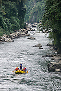 Bhutan, Mangde Chu expdition, first descent of the lower Mangde Chu, (chu means river). A Discvoery Channel and BBC 2 hour documentary, Expedition Leader Gerry Moffatt, is standing in the back of a raft scouting an upcominmg rapid
