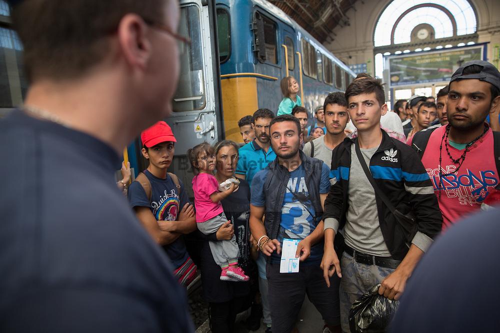 Budapest, Hungary - 01.09.2015<br /> <br /> Police clears the East Station in Budapest. Trains do not leave anymore. The day before, many refugees were given the opportunity to buy train tickets to Germany and Austria - they are now stuck in Budapest again, despite the tickets they are not allowed to use the trains. For some days the station resembles a refugee camp.<br /> <br /> Polizei r&auml;umt den Ostbahnhof in Budapest. Z&uuml;ge fahren nicht mehr ab. Nachdem am Vortag viele Fluechtlinge die Moeglichkeit bekamen Zugtickets nach Deutschland und Oesterreich zu kaufen - stecken diese nun wieder in Budapest fest, trotz Fahrkarten duerfen sie nun erneut keine Zuege benutzen. Seit einigen Tagen gleicht der Bahnhof einem Fluechtlingscamp.<br /> <br /> Photo: Bjoern Kietzmann