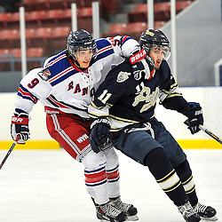 Toronto, ON - Feb 16 : Ontario Junior Hockey League Game Action between the North York Rangers Hockey Club and the Toronto Lakeshore Patriots Hockey Club.  Ted Hunt #9 of the North York Rangers Hockey Club and Niko Kovachis #11 of the Toronto Lakeshore Patriots Hockey Club battle for the puck during first period game action.<br /> (Photo by Gary Keys / OJHL Images)
