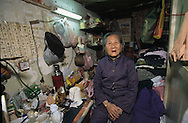 "Hong Kong. Mrs. Leung Shan; (83 years) is living since 40 years in a cage home in Mongkok area/ / /    / Mme Leung Shan; 83ans vit depuis 40 ans dans un lit cage à ""Mongkok""./ /  /  / R00263/4    L3425  /  R00263  /  P0006143"