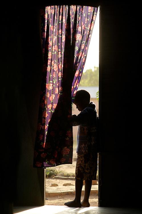 Natitingou November 2006 - A boy at the door of his house in Natitingou, Benin. © Jean-Michel Clajot