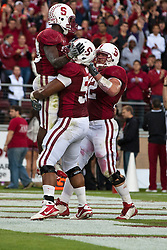 October 23, 2010; Stanford, CA, USA;  Stanford Cardinal running back Stepfan Taylor (33) (left) celebrates with teammates after scoring a touchdown against the Washington State Cougars during the second quarter at Stanford Stadium.