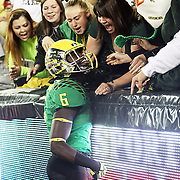 De'Anthony Thomas gets up close and personal with the fans as the Oregon Ducks host the University of Washington in a Pac-12 college football battle at Autzen Stadium.