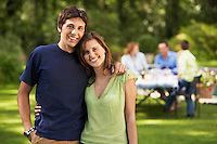 Young Couple in back yard portrait