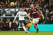 Derby County forward Tom Lawrence (10) and Aston Villa defender Alan Hutton (21) during the EFL Sky Bet Championship match between Derby County and Aston Villa at the Pride Park, Derby, England on 10 November 2018.
