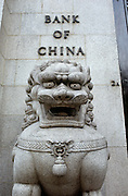 We see one of a pair of lion guards outside the Bank of China's building in Macau (Macao), in China's Special Economic region (SER). Stone lions, also called Shishi in Chinese, are often found in pairs in front of the gates of Chinese traditional buildings. Chinese guardian lions, known also as stone lions in Chinese art, are a common representation of the lion in pre-modern China. They are believed to have powerful mythic protective powers that has traditionally stood in front of Chinese Imperial palaces, Imperial tombs, government offices, temples, and the homes of government officials and the wealthy from the Han Dynasty (206 BC-AD 220). Pairs of guardian lions are still common decorative and symbolic elements at the entrances to restaurants, hotels, supermarkets and other structures.