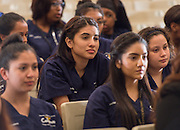 Students listen to comments during a media conference announcing a partnership between Jones Futures Academy and the Prairie View A&M Nursing School, April 15, 2015.