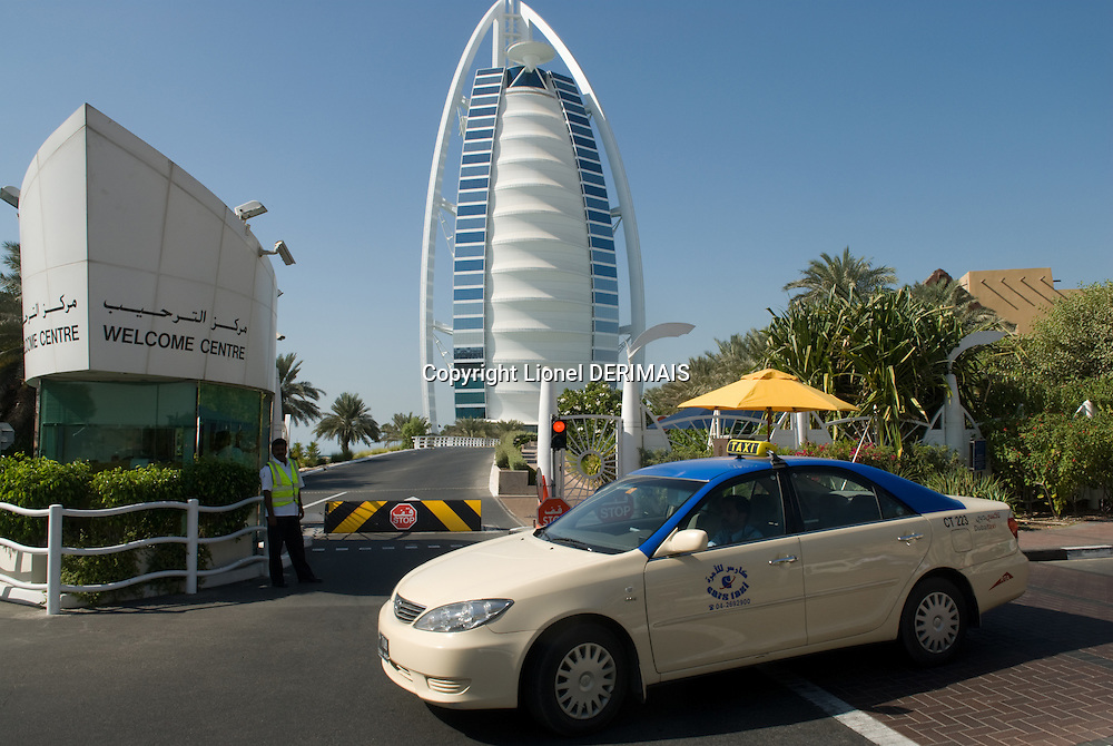 7-star hotel Burj al Arab designed by Tom Wright of Atkins. Dubai, one of the seven emirates and the most populous of the United Arab Emirates sits on the southern coast of the Persian gulf.
