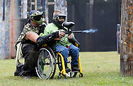 Evan Sugrue, 11, of Monsey fires his paintball gun with help from Ed Dykshoorn Jr. of the War Hounds paintball team at the Montgomery Sporting Goods paintball fields in the Town of Wallkill on Saturday, Sept. 21, 2013.