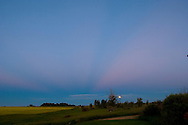 Nearly Full Moon and Jupiter rising in Earth's shadow with belt of Venus and crepuscular ray.