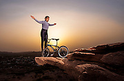 At dawn Khiv Raj Gurjar  does Power Yoga poses and stretches while balancing on a BMX bike on a rocky outcrop outside Jodhpur, Rajasthan, India, 21st May 2009.<br /> <br />  Gurjar (57, born 05/12/48) is from Jodhpur, Rajastan. He has been fanatical about fitness all his life and established his own gym in Jodhpur. He was National Cycling Champion in 1972, player soccer at National level from 1966-67 and participated in the official Asian Body Building Championship in Taiwan in 1999 amongst many achievements. From around 2006 he began concentrating on his feats of balancing at great height on his BMX bike with no safety measures. He performs 17 yoga Asana's; 7 poses; 7 stretches and 5 balance moves in his routine.<br /> <br /> PHOTOGRAPH BY SIMON DE TREY-WHITE / BARCROFT MEDIA photographer in delhi