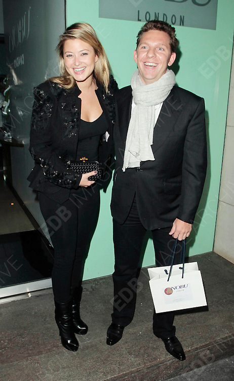 04.OCTOBER.2010. LONDON<br /> <br /> HOLLY VALANCE AND BOYFRIEND NICK CANDY LEAVING THE NOBU RESAURANT, BERKLEY SQUARE.<br /> <br /> BYLINE: EDBIMAGEARCHIVE.COM<br /> <br /> *THIS IMAGE IS STRICTLY FOR UK NEWSPAPERS AND MAGAZINES ONLY*<br /> *FOR WORLD WIDE SALES AND WEB USE PLEASE CONTACT EDBIMAGEARCHIVE - 0208 954 5968*