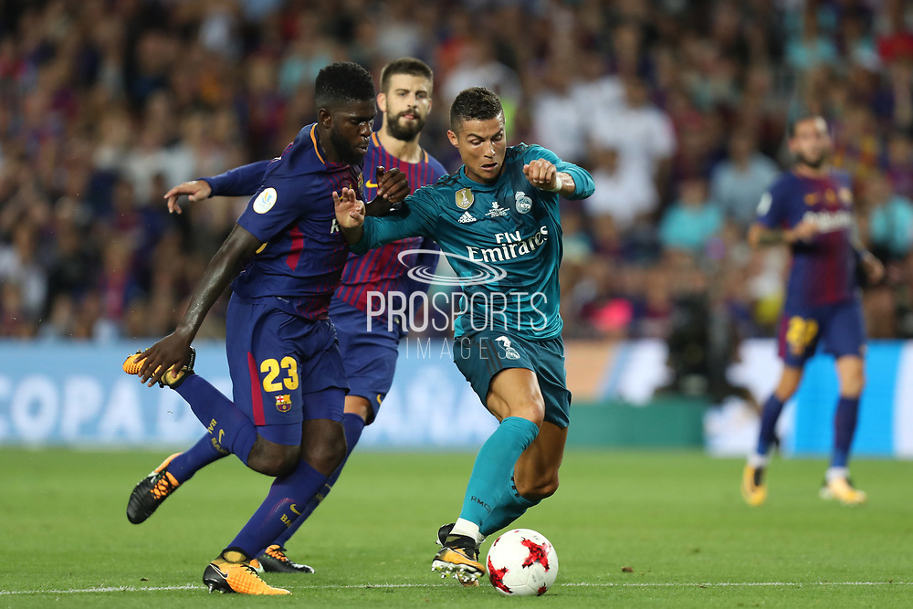 Cristiano Ronaldo of Real Madrid duels for the ball with Samuel Umtiti of FC Barcelona during the Spanish Super Cup football match between FC Barcelona and Real Madrid on August 13, 2017 at Camp Nou stadium in Barcelona, Spain. - Photo Manuel Blondeau / AOP Press / ProSportsImages / DPPI