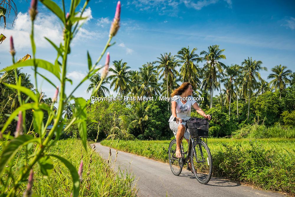 Kota Bharu, Malaysia, October 2016. Life in the kampung, the villages around Kota bharu is easily explored by bicycle and kayak from Pasir Belanda.  Mainland Malaysia is made up primary and secondary rainforest, misty tea plantations, and colonial heritage that transformed into bustling multicultural cities. Photo by Frits Meyst / MeystPhoto.com