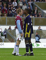 Photo. Glyn Thomas<br />Wimbledon v Burnley. Nationwide Division 1.<br />National Hockey Stadium, Milton Keynes. 27/09/2003.<br />Wimbledon's Mikele Leigertwood (R) exchanges angry words with Ian Moore.