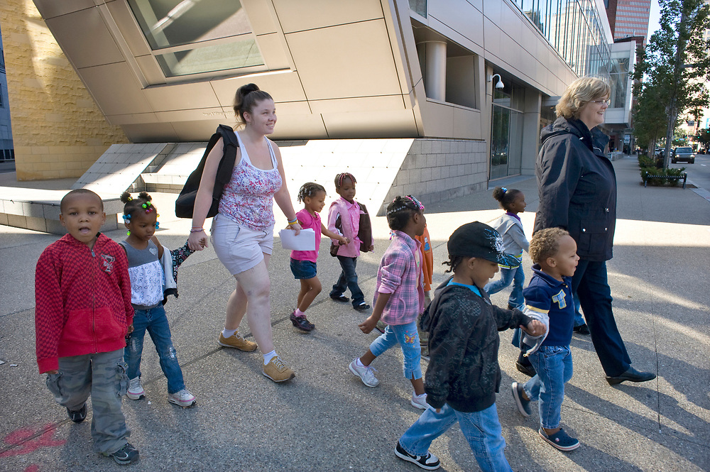 Director Lynne Geidel and assistant Michelle Gabig prepare to cross Liberty Avenue at 10th Street with their preschool students from Small World 2 Early Learning & Development Center while taking a walk in downtown Pittsburgh.