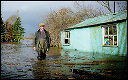 UKIP Leader Nigel Farage walks in the flood water in someones back garden in Burrowbridge, Somerset, United Kingdom. Sunday, 9th February 2014. Somerset has been flooded since the start of 2014, with people being forced to leave their homes. Picture by Andrew Parsons / i-Images