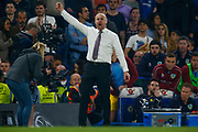 Burnley manager Sean Dyche celebrates as he thinks the whistle is about to be blown during the Premier League match between Chelsea and Burnley at Stamford Bridge, London, England on 21 April 2019.