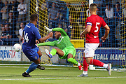 AFC Wimbledon Kyron Stabana (14) having his shot saved during the Pre-Season Friendly match between AFC Wimbledon and Bristol City at the Cherry Red Records Stadium, Kingston, England on 9 July 2019.