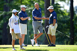 Brian Kelly, Jon Barry and Jimmy Dunne celebrate a shot during the Chick-fil-A Peach Bowl Challenge at the Oconee Golf Course at Reynolds Plantation, Sunday, May 1, 2018, in Greensboro, Georgia. (Dale Zanine via Abell Images for Chick-fil-A Peach Bowl Challenge)