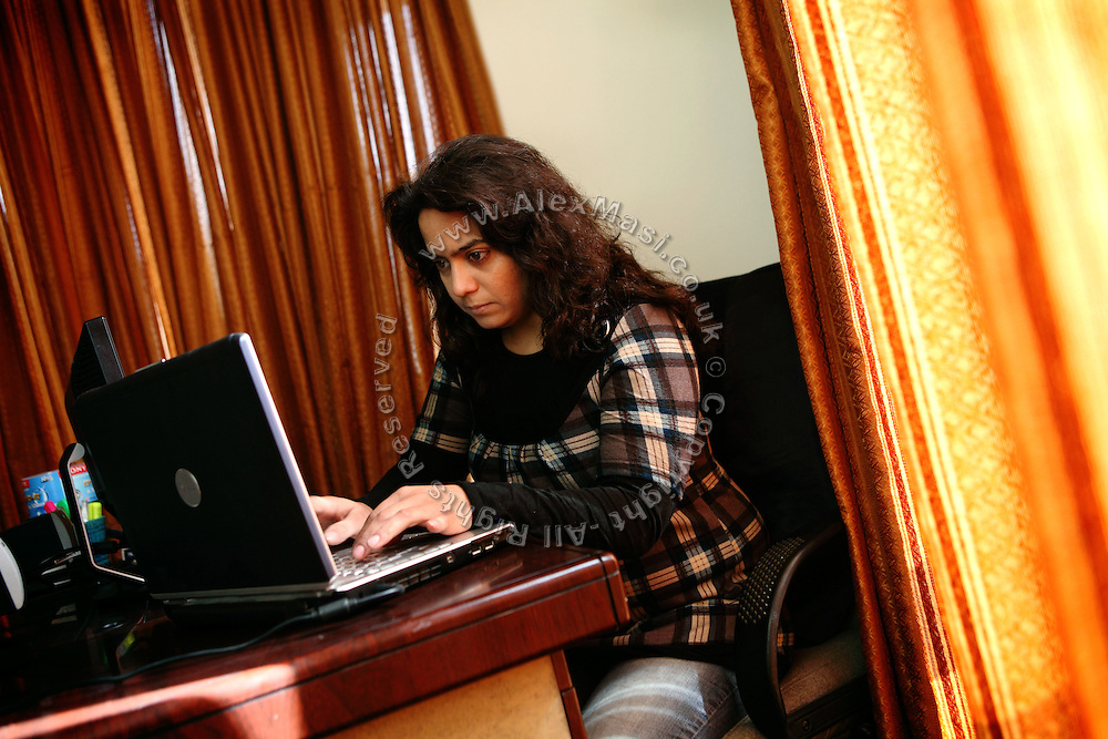 Diana Saqib, 29, a renowned Afghan documentary filmmaker, is writing on her laptop inside her home in Kabul, Afghanistan. Diana's most famous production to date is titled 'Twenty-Five Per Cent' and focus on the lives of six women MPs in Afghanistan .