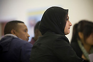 A class of students being taught basic English at Befriending Refugees and Asylum Seekers (BRASS) in Bolton, Greater Manchester, northwest England. The project was established in 2001 and run by Bolton Methodist Mission as a drop-in centre for asylum seekers, refugees and refused asylum seekers.