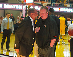 Nov 23, 2015; Morgantown, WV, USA; West Virginia Mountaineers head coach Bob Huggins talks with Texas Tech Red Raiders head coach Tubby Smith before the game at WVU Coliseum. Mandatory Credit: Ben Queen-USA TODAY Sports
